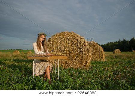 Girl playing on cymbalo