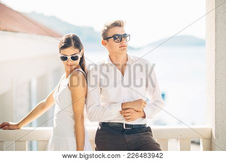 Attractive Couple Looking At Amazing Sea View.enjoying Sun And Sunny Weather And Breathing In Fresh