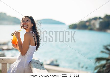 Carefree Young Female On Holiday Summer Vacation Having Fun On A Sunny Day,relaxing With Ocean View,