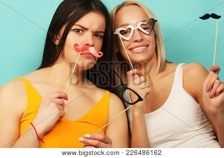 life style and people concept: stylish girls best friends ready for party