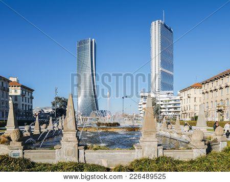 Fountain Of The Four Seasons In Piazza Giulio Cesare, Citylife, With Il Dritto And Il Storto Skyscra