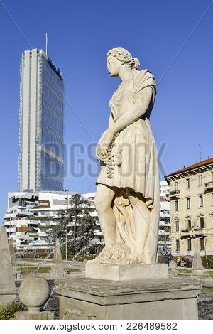 Juxtaposition Of Statue At Fountain Of The Four Seasons In Piazza Giulio Cesare, Citylife, With Il D