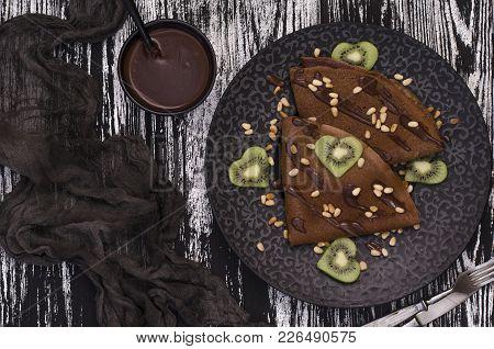 Chocolate Pancakes With Chocolate Sauce And Kiwi