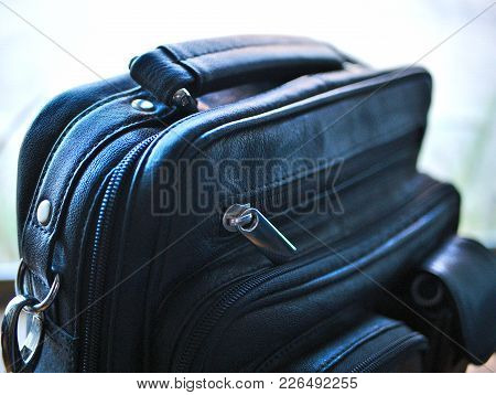Black Leather Luggage With Zippers And Handle.