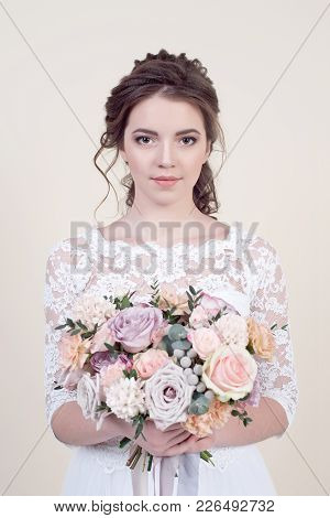Beautiful Female Model With Perfect Fashion Makeup And Hairstyle. Elegant Female Hairstyle For The W