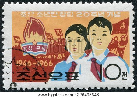 North Korea - Circa 1966: A Stamp Printed In North Korea, Is Dedicated To The 20th Anniversary Of Th