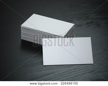 White blank business cards mockup on black wood table background, 3d illustration