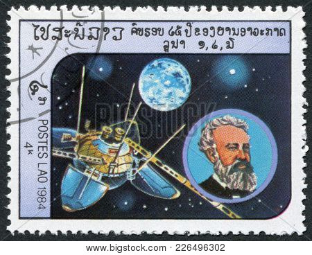Laos-circa 1984: A Stamp Printed In The Laos, Depicts The Spacecraft Luna 13, And A Portrait Of Jule