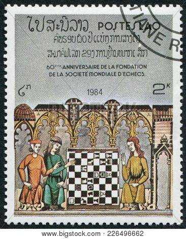 Laos-circa 1984: A Stamp Printed In The Laos, Dedicated To The 60 Anniversary Of The World Chess Fed