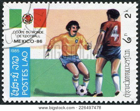 Laos-circa 1985: A Stamp Printed In The Laos, Is Dedicated To Fifa World Cup In Mexico, Circa 1985