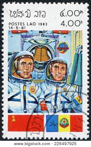 Laos-circa 1983: A Stamp Printed In The Laos, A Symbol Intercosmos - Space Cooperation Program Of Th
