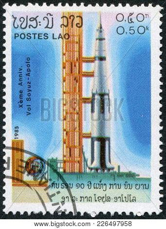 Laos-circa 1985: A Stamp Printed In The Laos, Is Pictured Launching The Spacecraft Apollo Program Ap