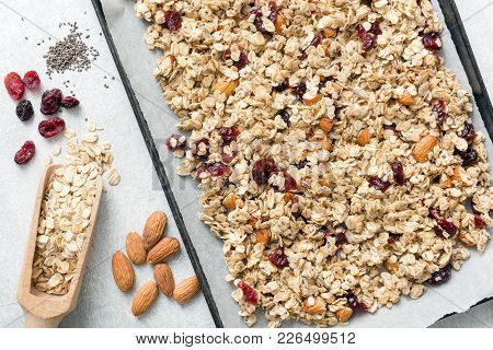 Homemade Granola On Baking Sheet And Ingredients. Top View. Concept Of Healthy Lifestyle, Healthy Ea