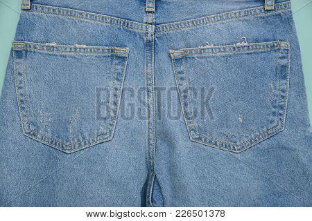 Back of blue jeans background