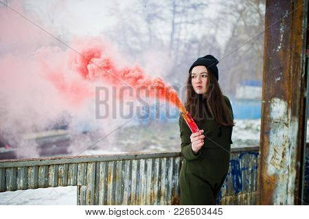 Young Girl With Red Colored Smoke Bomb In Hand.