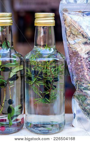 Tincture Of Juniper. Homemade Alcoholic Beverage. Home Remedy. Tincture In A Transparent Bottle.