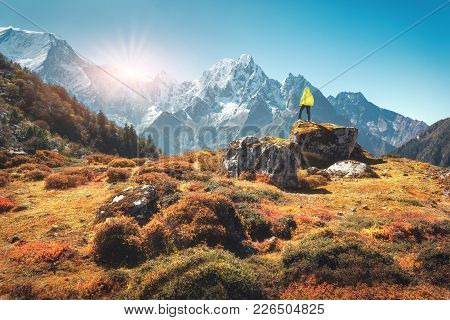 Standing Man On The Stone And Looking On Amazing Himalayan Mountains At Sunset. Landscape With Trave