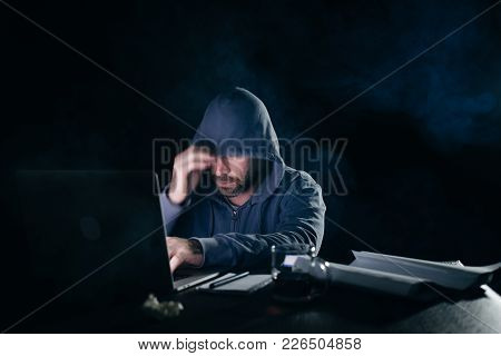 Mysterious Bearded Man Hides His Face Under The Hood, Hacks The Laptop