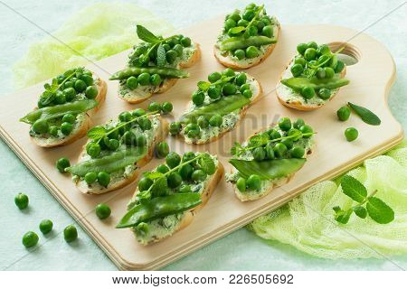 Fresh Spring Toast With Cottage Cheese And Herbs, Green Peas And Sprouts Of Mint. Idea Of Recipe. Co