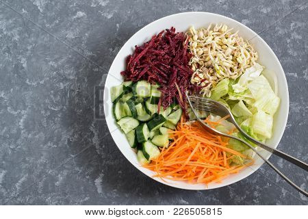 Vegetarian Lunch Bowl With Sprouted Beans Mung, Carrot, Beet, Cucumber, Iceberg Lettuce On Gray Back