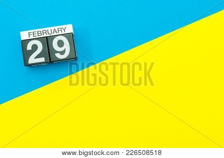 February 29th. Day 29 Of February Month, Calendar On Blue And Yellow Background Flat Lay, Top View.