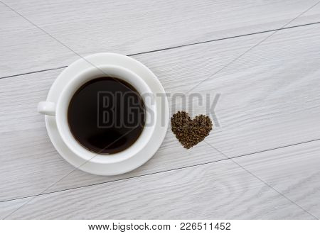 Top View Of Hot Cup Of Black Instant Coffee With Heart Shape On White Wooden Table With Copy Space,
