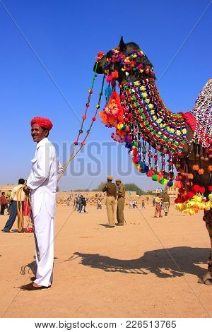 Jaisalmer, India - February 16: Unidentified Man Stands With Camel During Desert Festival On Februar
