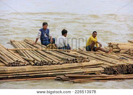 Mandalay, Myanmar - December 30: Unidentified Men Float  On A Bamboo Raft Down Ayeyarwady River On D
