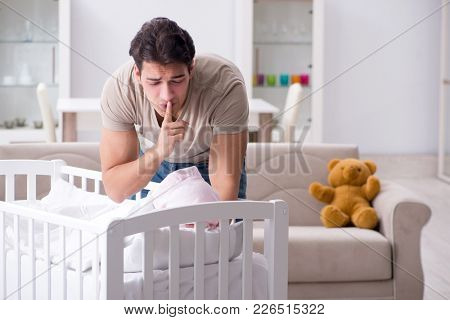 Young father dad frustrated at crying baby