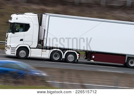 Lorry, Heavy Goods Vehicle In Motion On The Road