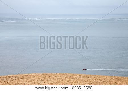 Boat Sailing On The Atlantic Ocean During A Rain Story Under A Cloudy Sky Passing Next To The Pyla D