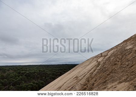 Panorama Of The Pilat Dune (dune Du Pilat) During A Cloudy Afternoon With The Landes Forest (foret D