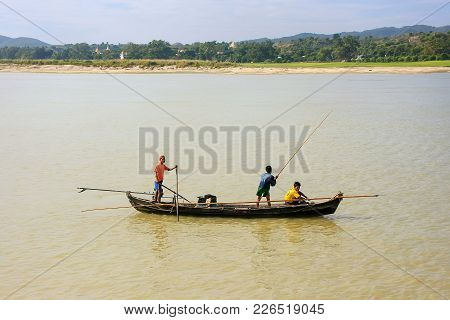 Mandalay, Myanmar - December 30: Unidentified Men Fish From A A Boat On Ayeyarwady River On December