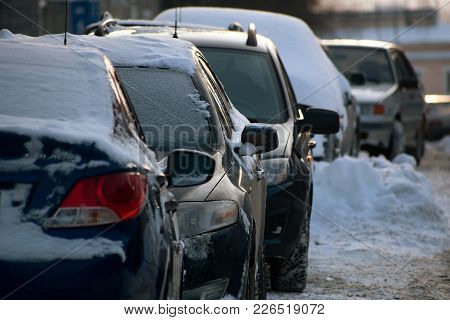 Yoshkar-ola, Russia - February 9, 2018 Cars Covered With Snow Parked In The Yard
