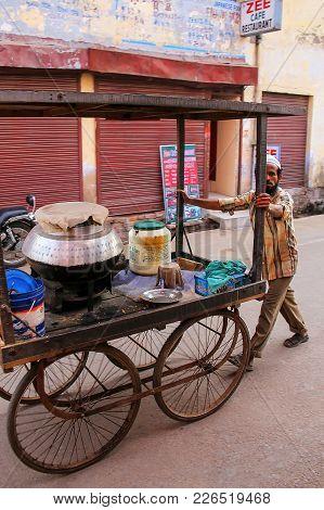 Agra, India - November 10: Unidentified Man Pushes Food Cart In Taj Ganj Neighborhood On November 10