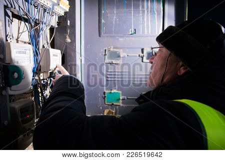 Yoshkar-ola, Russia - February 17, 2017 Electrician Checking Of Electricity Consumption In One Of Th