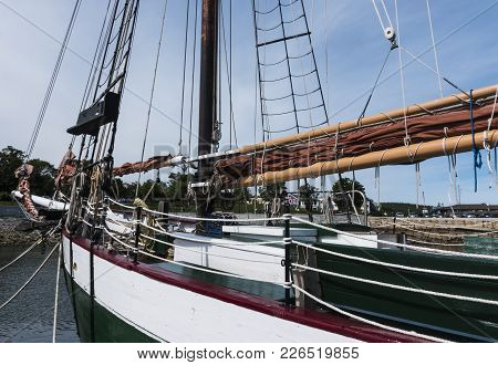 The Bow Of A Wooden Sailboat Moored In Bar Harbor Maine.