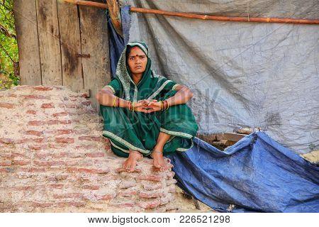 Agra, India - November 8: Unidentified Woman Sits On A Brick Wall In Taj Ganj Neighborhood On Novemb
