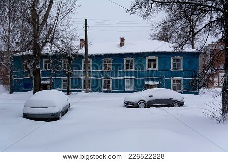 Yoshkar-ola, Russia - February 10, 2018 Old Emergency Residential House Covered With Snow, After A H