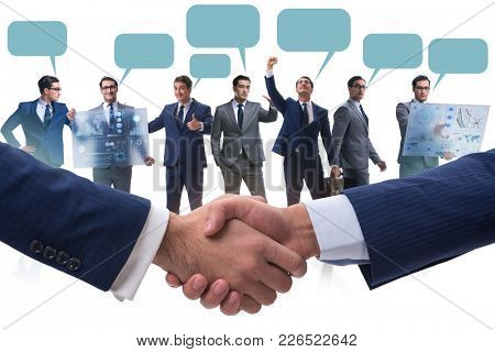 Cooperation and teamwork concept with handshake