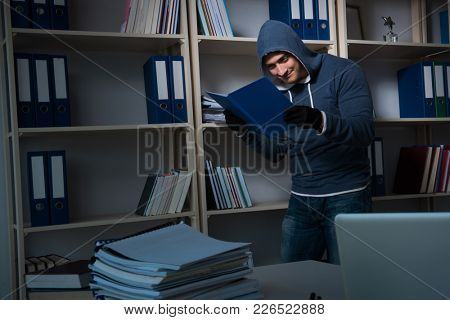 Young man in industrial espionage concept