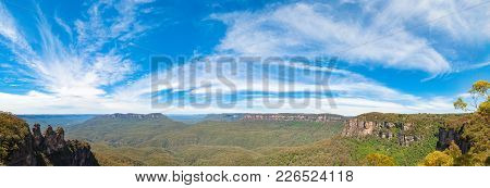 Picturesque Panorama Of Three Sisters Rock Formation And Vast Eucalyptus Forest Under Spectacular Sk