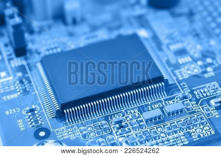 Closeup Of Chip. Electronic Circuit Board With Chip. Macro With Extremely Shallow Dof.