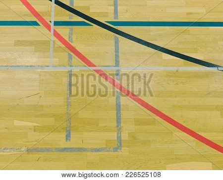 Renewal Wooden Floor Of Sports Hall With Colorful Marking Lines And New Lacquered Surface. White Bla