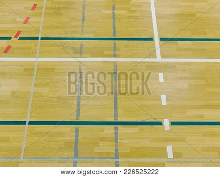 Wooden Floor In Sporting Hall With Solid And Dotted Lines.  Light Reflection In Polished Wooden Floo