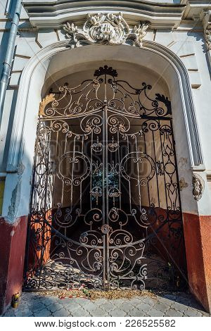 Gates Of Mansion With Old-time Forged Decorative Lattice.