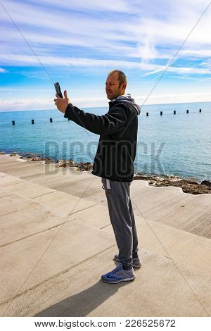 Chicago, Il, United States - March 12, 2017: A Man Is Taking A Self-portrait (selfie) Picture In Chi