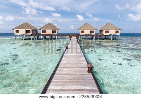 Water Villas On Crystal Clear Water At Tropical Island