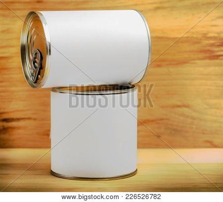 food tin cans on wood background
