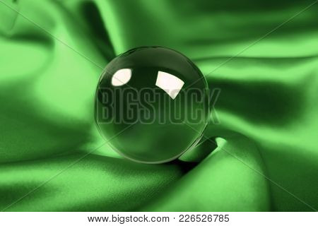 glowing crystal ball  on green background
